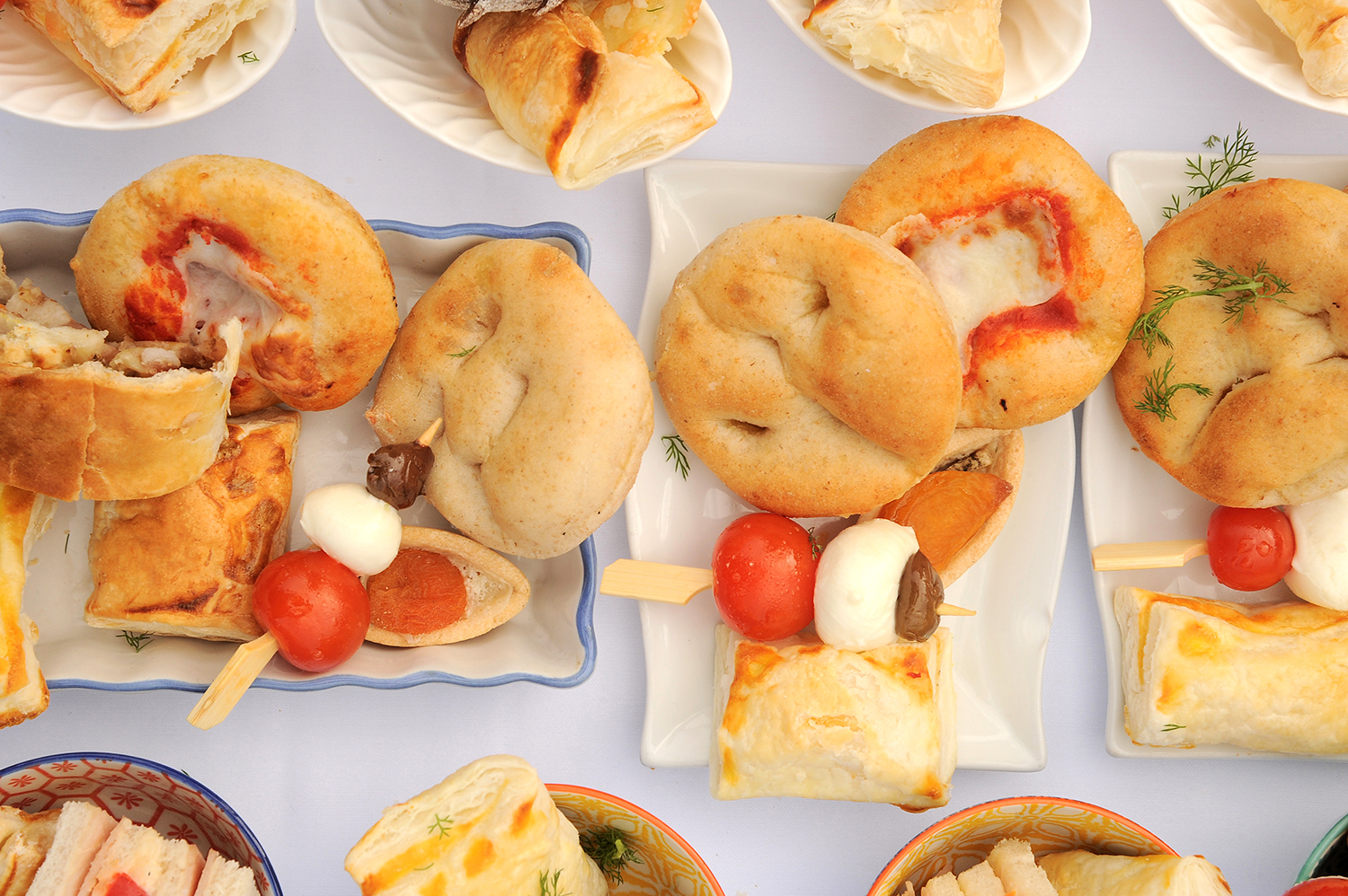 Milan Italy 04/13/2019 ,Catering : buffet of Italian pretzels  , small pizzas with tomato and mozzarella, rustic with wurstel, pizzette puff pastry, traditional savory pastries